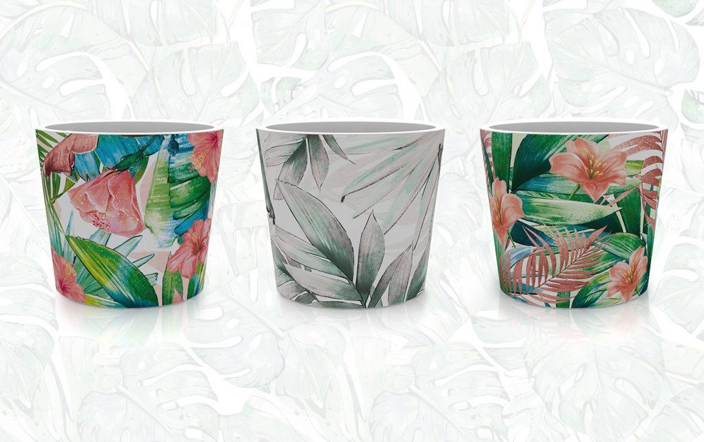 Blumentopf Designs mit tropischen Blättern und Blumen/Blüten